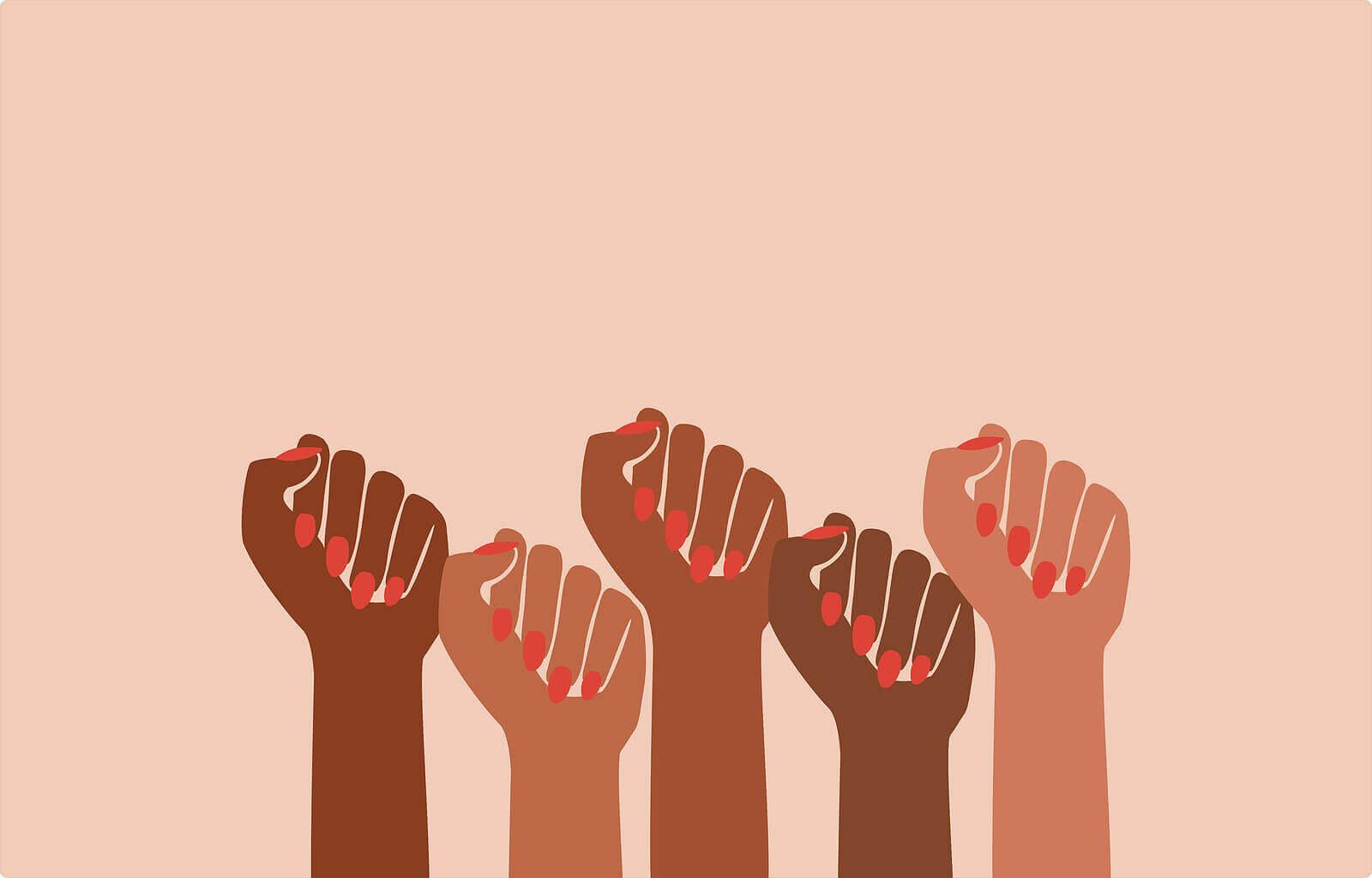 Punhos erguidos para o Dia Internacional da Mulher.